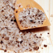 Natural coloured bath salt scattered — Stock Photo