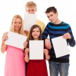 Happy brothers and sisters with empty paper — Stock Photo #25255051