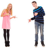 Brother and sister shows on something — Stock Photo