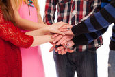 Friends holding hands together — Stock Photo