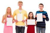 Gelukkig broeders en zusters met lege papier — Stockfoto