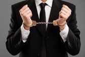 Businessman with manacles on his hands — Stock Photo