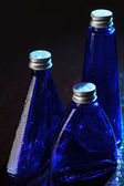 Little blue bottles on a background — Stock Photo
