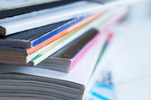 Pile of colorful magazines on a table — Stock Photo