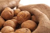 Closeup image of a rustic unpeeled potatoes — Stock Photo