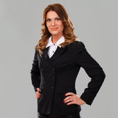 Beautiful caucasian businesswoman in suit — Stock Photo