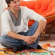 Stock Photo: Young mplaying game at home