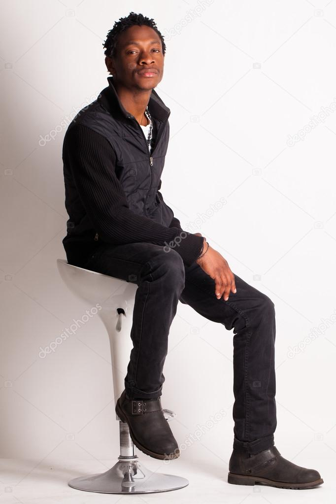 Handsome Black Guy Sitting On A Chair Stock Photo 25924395