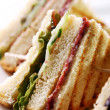 Club sandwich with meat and green — Stock Photo #26368799