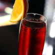 Red cocktail in a champagne glass — Stock Photo #26369007