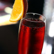 Red cocktail in a champagne glass — Stock Photo