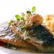 Stock Photo: Gourmet grilled fish served with prawns