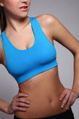 Woman's body in a fitness wear — Stock Photo