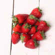 Fresh strawberry on a white table — Foto Stock