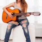 Young beautiful woman playing guitar — Stock Photo