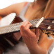 Closeup image of guitar in woman hands — Stock Photo
