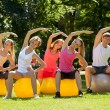 Young caucasians working out in a park — Stock Photo