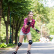Girl riding rollerblades — Stock Photo
