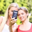 Two girls are taking photos of themselves — Stock Photo