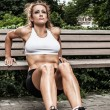 Fitness girl is working out in the park — Stock Photo