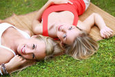 Two girls are having fun in the park — Stok fotoğraf
