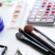 Cosmetic brushes with powder — Stock Photo