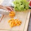 Vegetables being sliced — Stock Photo