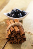Stack of cinnamon and blueberries on a plate — Stock Photo