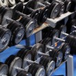 Stock Photo: A set up with many dumbbells