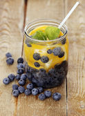 Bilberry drink with lemon — Stock Photo