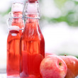Bottles with red drinks and some apples — Stock Photo #31730673