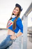 Stylish girl with long hair posing near river — Stock Photo