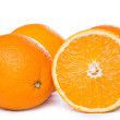Sliced and whole oranges — Stock Photo