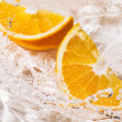 Slices of an orange in water — Stock Photo