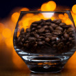 Glass with coffee beans — Stock Photo