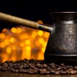 Exotic cezve and coffee beans around — Stock Photo