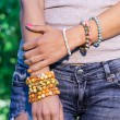 Colorful bracelet on a womans' hand — Stock Photo