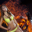 Woman in bikini near bonfire — Stock Photo