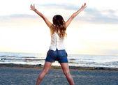 Beautiful girl posing near the sea — Stock Photo