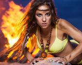 Woman in bikini near bonfire — Stock Photo