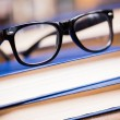 Glasses and book — Stock Photo #37176629