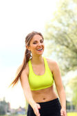 Beautiful woman working out in a park — Foto Stock