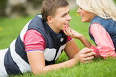 Young passionate couple at park — Stock Photo