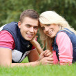 Young couple expressing their feelings at park — Stock Photo #37483643