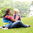 Young couple expressing their feelings at park — Stock Photo #37483659