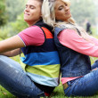 Young couple expressing their feelings at a park — Stockfoto