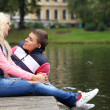 Stock Photo: Young couple expressing their feelings at park