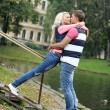 Young couple expressing their feelings at park — Stock Photo #37483691