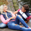 Young couple expressing their feelings at park — Stock Photo #37483697
