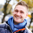 Cute guy having a walk in cold autumn day — Stock Photo #37484143